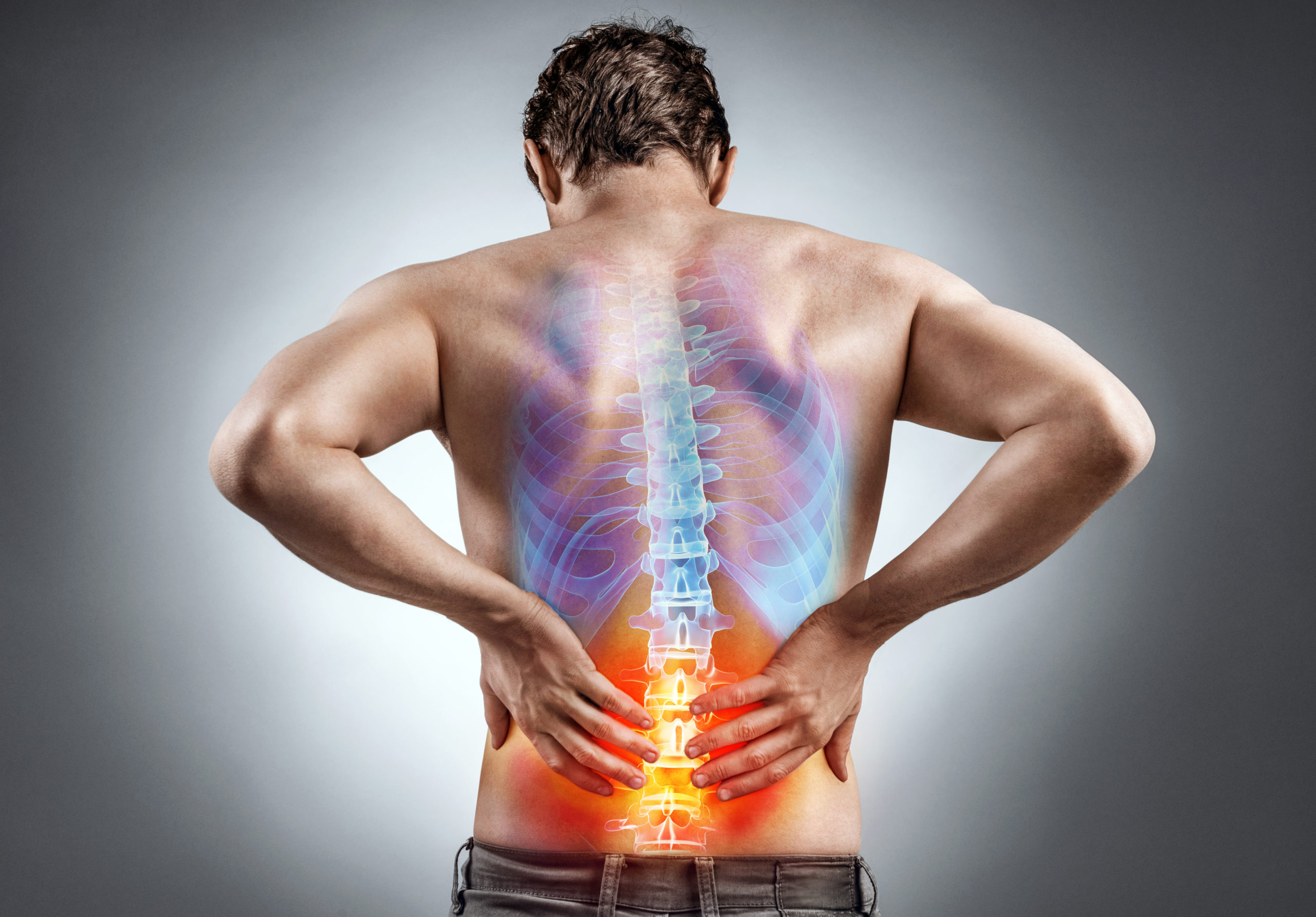 man holding back do to lower back pain